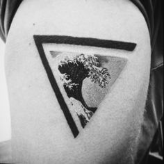 Japanese great wave tattoo in triangle symbol of strength