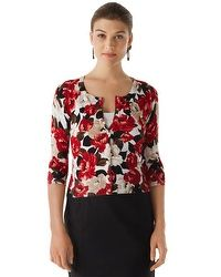 This snap button cardigan can double as a shirt in the fall with a camisole underneath.