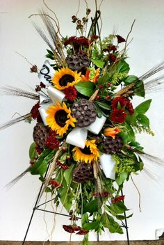 Sunflower/Lotus pods Fall Funeral flowers designed by floralsbysharon