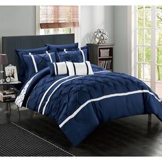 Dress up your bedroom decor with this sophisticated 10-piece comforter set. This reversible design showcases stunning navy blue and white detailing and a pinch pleat texture. This bedding comes comple