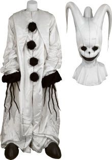 """A 'Luna Ghost' Costume from """"Scooby-Doo."""" Warner Bros., 2002. Seen at the opening of the film as the focus of Mystery, Inc.'s first solved case (the Luna Ghost is revealed to be a villainous janitor played by Nicholas Hope); the four-piece ensemble includes a white nylon triple-horned headpiece, a puffy white bodysuit with black faux fur trim, a pair of black rubber-covered handpieces, and a pair of black and white clown shoes. (Please note there is minor wear from production use.) Requires…"""