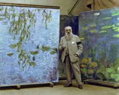 Colorized picture of Claude Monet standing next to paintings from his Water Lilies series, 1923 : interestingasfuck