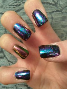 unicorn pigment over black on ring finger with pixie watch on the rest over black