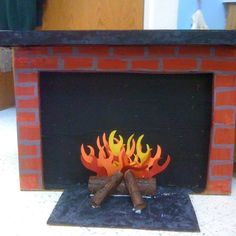 Cardboard fireplace. Preschool Projects, Art Projects, All Things Christmas, Christmas Ideas, Fake Fire, Fire Crafts, Cardboard Fireplace, Christmas Fireplace, Ace Hardware