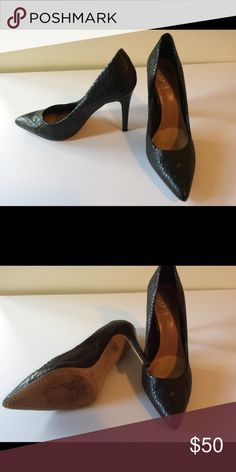 Vince Camuto black snake skin heels Black snake skin leather high heals like new. Worn only a few times Vince Camuto Shoes Heels
