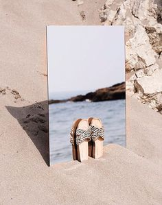 Product photography layout ideas | Creative Footwear photo layout | summer sandals in the sand