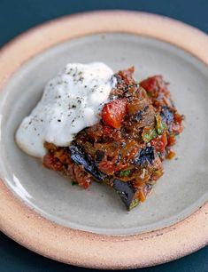 Spiced aubergine and tomatoes with yogurt. This spiced aubergine and tomatoes dish is from Jeremie Cometto-Lingenheim and David Gingell's new seafood-focused restaurant, Westerns Laundry. This vegetarian recipe is easy to make and packed with punchy flavours