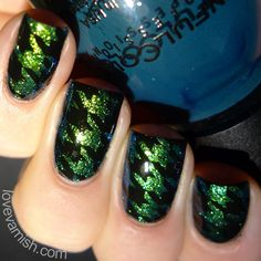 Pinned from www.lovevarnish.com Nail art // 40 Great Nail Art Ideas - Glitter topper or flakie