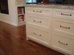 Full Overlay Cabinets With White Marble Counter Condo Kitchen Stools