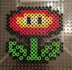 Mario Fire Flower Perler bead Pattern- Click the picture for more patterns Melty Bead Patterns, Pearler Bead Patterns, Bead Loom Patterns, Perler Patterns, Beading Patterns, Color Patterns, Perler Bead Mario, Pokemon Perler Beads, Diy Perler Beads