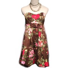 "Pretty flower patterned dress. Perfect for Spring! Measures 25"" in length. Bust: 28"" waist 28"" Ruby Rox Dresses"