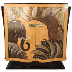 Unique, one of a Kind Armoire attributed to Louis Midavaine, brother of Jacques Midavaine. Brown lacquer and fruitwood. Elephant and abstract nature motif with silver and gold leaf. Shelving and drawers inside.  1930's  Asking $30,000