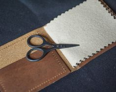 We're huge fans of Merchant & Mills here at The Drapers Daughter and their Leather Needle Wallet makes a great gift and includes a free pair of baby Bow Scissors. #sewing #dressmaking #make #create #merchantandmills
