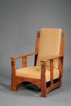 Arts & Crafts Upholstered Pewter and Ebony Inlaid Oak Armchair.