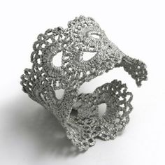 Lace & fabric stiffener to create bad ass cuff.  Also great idea for creating headbands etc