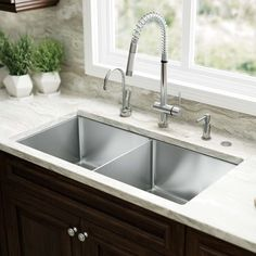 Picking a kitchen sink is a huge part of kitchen restoration. From typical top-mount sinks to newer, trendier devices like the reduced divider panel sink, think about which sort of sink suits your . Read Basic Kitchen Sink Types Ideas You Must Know Best Kitchen Sinks, Kitchen Sink Design, Kitchen Sink Faucets, Cool Kitchens, Bar Sink, Kitchen Sink Ideas Undermount, Franke Kitchen Sinks, Remodeled Kitchens, Sink Top