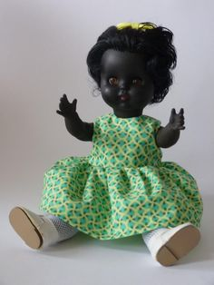 "Black #VintageDoll - Milly 14inch, £20.00 by DollQ:   Cute little black doll ""Made in England"" Circa 1960. Rubber head, arms, hard plastic body & legs. Sleeping eyes and rooted hair. Comes with a lovely hand made bright cotton dress, white lace edged panties and vintage socks and shoes. Excellent condition."