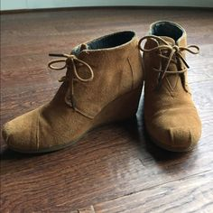 TOMS Desert Wedge Ankle Booties Gorgeous suede ankle booties by TOMS. Slight discoloration on the right back heel from wear (pictured). Overall great condition. Comfortable, wear-all-day shoes that go with anything. TOMS Shoes Ankle Boots & Booties
