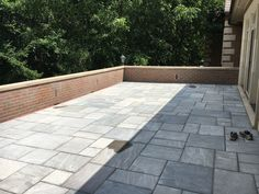 Blue Quartz Paver Patio on top of a garage roof. Water proof membrane is set underneath the pavers and behind the veneer on the wall. Landscape Materials, Landscape Design, Bluestone Pavers, Step Treads, Sandstone Wall, Natural Stone Veneer, Garage Roof, Landscape Maintenance, Outdoor Areas