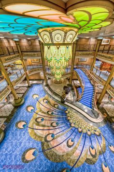 https://flic.kr/p/ctQcvu   Disney Fantasy - Lobby Atrium from Deck 5   Reminiscent of early Golden Age ocean liners, the Disney Fantasy's 3-deck Atrium Lobby is awash of Art Nouveau-inspired details, from the vibrant carpet to the spectacular chandelier.  The centerpiece of the lobby is the bronze statue of Mademoiselle Minnie Mouse.      Disney Cruise Line   Disney Fantasy -  Atrium Lobby, Deck 3      Disney Cruise Line Blog