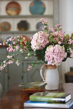 love the soft floral with the country stoneware vase  :)