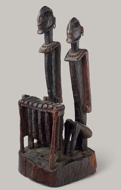 Dogon pair of balafon players, Mali, c.18th-early 19th century (wood, metal)
