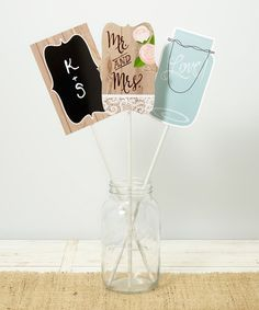 Dress up your reception tables with these darling centerpiece sticks that offer rustic charm and simple elegance.