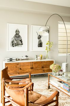 Special midcentury modern pieces add warmth to the muted whites of our designer's beautiful San Francisco two bedroom. Travel collected treasures imbue the home with sentimental value and a total home renovation took this home from brown and drab to bright and airy. Dream home, indeed!