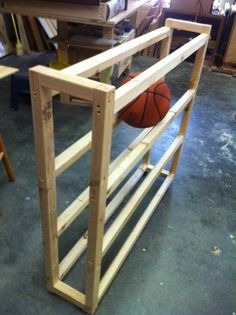 diy Basketball rack. A rolling metal one would be better, but this will do!