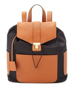Leave it to Tory Burch to design classic, practical and affordable. This one, nylon and leather, $295. at Neiman.   Penn Nylon & Leather Backpack, Black/Tan by Tory Burch at Neiman Marcus.