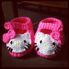 Crocheted hello kitty baby booties