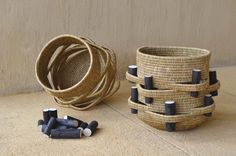 The Gogo Collection - Children (part 1 and 2) baskets, handwoven from natural lutindzi grass and featuring laser-cut wooden blocks with the names of Gogo's children. By Gone Rural.