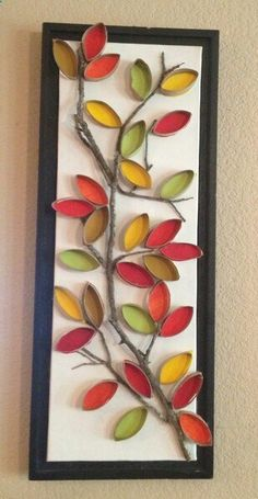 Toilet paper roll craft art with tree branch and mod flowers