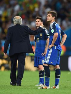 Head coach Alejandro Sabella consoles Lionel Messi of Argentina after..