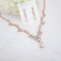 For the look of real diamonds and rose gold, dont miss this AAA grade CZ necklace and earrings set. The . Add this fabulous statement necklace to your wedding day or special occasion today and wow everyone. This set is also a perfect for mothers of the bride. The neck is 16 3/4 and the earrings are 1 3/8 h.