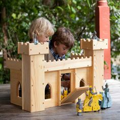 Children who love knights and dragons, kings and queens, and stories of long ago and far away, will enjoy hours of imaginative play with this beautiful handcrafted Wooden Toy Castle! Imported from Ger