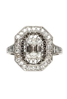 """Brides.com: . """"Wimbledon"""" vintage-inspired ring, features 1.04ct emerald-cut diamond surrounded by an octagonal halo of diamonds and ornate filigree, $11,250, Trumpet"""