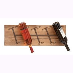 @Overstock.com - Wood and Metal Wall Wine Rack - This trendy wood and metal wine rack is perfect for your modern home. Made with reclaimed wood and iron alloy bottle holders, this restoration-style wine rack is the perfect addition to your kitchen or bar.  http://www.overstock.com/Home-Garden/Wood-and-Metal-Wall-Wine-Rack/8280770/product.html?CID=214117 $39.99