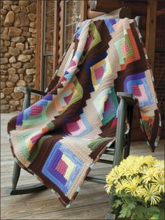 Log Cabin Scrapghan Crochet Pattern Download from e-PatternsCentral.com -- The timeless Log Cabin quilt pattern makes good use of those leftover yarns.