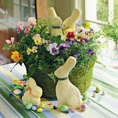 Easter Flowers | Decorate your Easter table with colorful blooms, candies, and bunnies. Hide the flowers' container with moss for a fresh, Spring look. | SouthernLiving.com