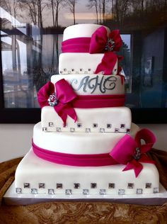 Gum Paste Fuchsia ribbon and bows, with diamond accents, make this mixed shape wedding cakes simple design very glamourous.