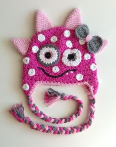 This adorable monster hat is perfect for your little monster! This crochet monster hat is made in bright pink with white polka dots. The light