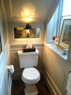 Powder room under stairs? This tiny powder room, which is tuck away under the stairs, makes a big impact with the trimwork. Bathroom Under Stairs, Attic Bathroom, Bathroom Layout, Small Bathroom, Toilet Under Stairs, Bathroom Ideas, Bathroom Ladder, Bathroom Designs, Bathroom Remodeling