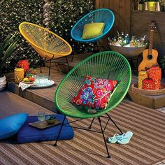 Create a hip outdoor space with these cool Acapulco accent chairs.