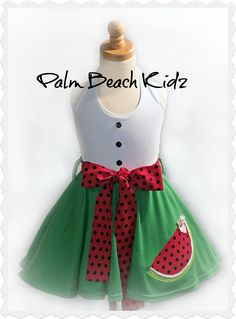 Watermelon Patch Twirl Dress - Soft knits make this halter style dress the perfect one for a pretty, yet comfy fit that she'll enjoy twirling while she wears. Elastic in the back for a nice adjustable fit and dress is picture over a tutu (not included) to demonstrate fullness. Great for parties, pageants or any event. Add a matching hair bow. https://www.facebook.com/palmbeachkidz/photos/a.146607928692768.21699.146607052026189/1533611429992404/?type=3&theater