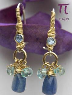 """Pendientes de zirconita azul cielo, apatites azul y kyanita engarzadas en una base de plata 925 y adornadas con oro """"gold filled"""" de 14k."""
