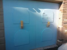 This person is building a crypt wall using styrofoam on his garage.  To keep the boards up, he is using industrial sized magnets.  Great way to hang on a garage without damaging your garage door.  On Halloween Forum
