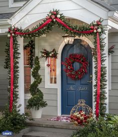 Make a festive first impression by trimming your front porch in holiday style. Reds, golds, berries, and greenery give this home an elegant, traditional entryway.