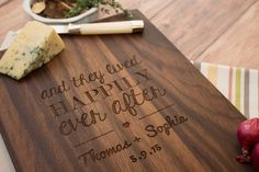 """Celebrate a wedding with a personalized """"fairy tail ending""""! This handcrafted wooden cutting board will delight the new bride and groom as they embark on their life together."""