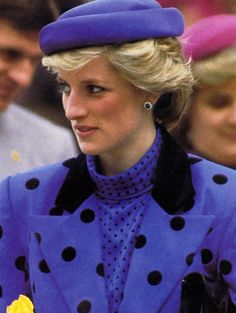 Princess Diana wore royal blue and black dotted two-piece suit and blouse by designer Jan Van Velden and topping off her outfit wearing a matching coloured hat by Graham Smith  at Kangol April 30, 1986 for the start of an 8 day Royal Tour in Canada.